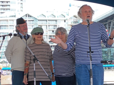 Explaining a song at Granville Island Wooden Boat Festival, 2018